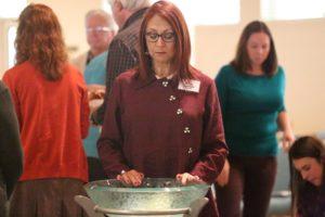 Woman prays over her pledge
